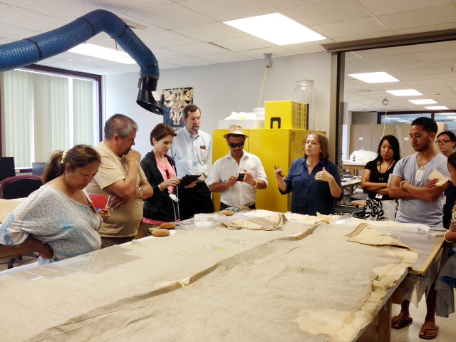 <p>The University of Hawaii delegation was treated to a special visit to the archives of the Smithsonian's Natural History and Anthropology Collections. They viewed kapa from the 1840s and intricate feather capes. They also saw the oldest Hawaiian canoe, which was donated by Queen Kapiolani to the Smithsonian.</p>