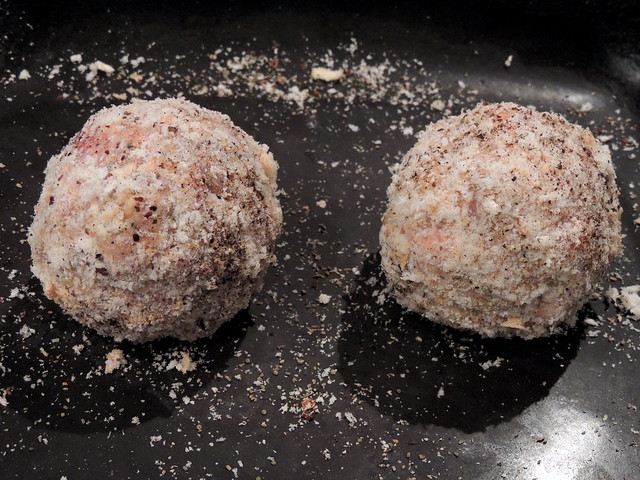 Raw Scotch eggs coated and seasoned