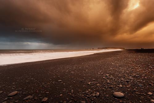 orange storm cold beach water clouds sunrise iceland vik islande icelandic waterscape