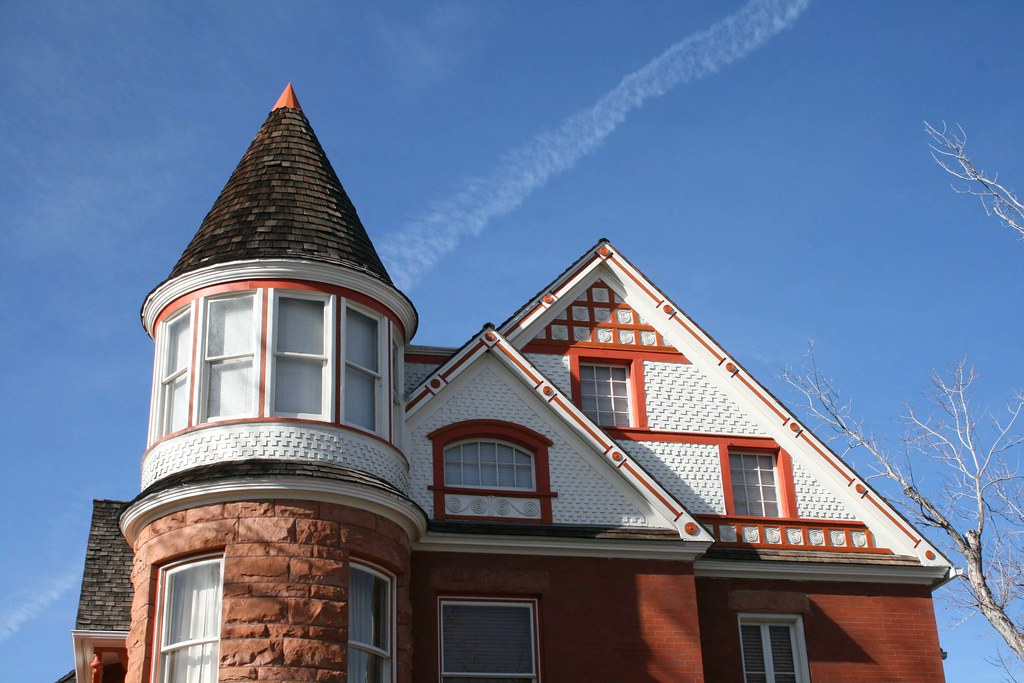 A colorfully-painted roof turret covered in wood shingle.