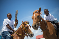 Kingsley Francis and son David, relay the Queen's Baton on horseback in Grand Turk Island, Turks and Caicos Islands, Thursday 17 April 2014. Turks and Caicos Islands is nation 56 of 70 nations and territories the Queen's Baton will visit....