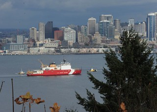 Coast Guard Cutter Healy, a 420-foot polar icebreaker homeported in Seattle, meets two tugboats in Puget Sound, Nov. 5, 2013. Commissioned in 1999, CGC Healy acts as a research platform for scientists in the Arctic and polar regions, as well maintaining search and rescue, environmental protection and law enforcement capabilities. U.S. Coast Guard photo by Petty Officer 3rd Class Katelyn Tyson.