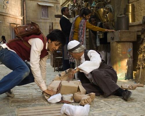 39325-ritesh-deshmukh-helping-old-man.jpg