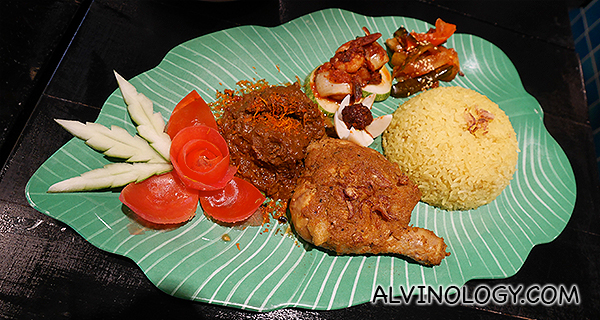 Nasi Peranakan Istimewa (Fragrant kunyit Rice served with soup, Chicken Rendang, prawn sambal, Achar, Keropok, Coconut Serunding, and curry.)