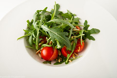 Rocket salad with cherry tomatoes and pine nuts