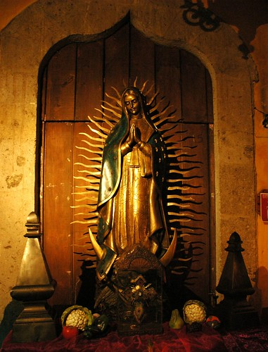 Our Lady of Guadalupe, statue with flaming halo, standing on a moon, The fountain of the archangel Saint Michael, La Fonda de San Miguel Arcangel, formerly El Convento de Santa Teresa de Jesus by Wonderlane