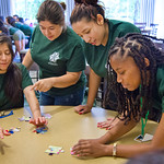 13-002 -- As an ice breaker during a MALANA pre-orientation session, participants closed their eyes and were directed in assembling a jigsaw puzzle by others. Fom left are members of the class of 2017: Clapitza Salgado, Edith Caballero, Lucero Sanchez and Antoinette Allen.