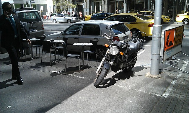 Parking in what appears to be a designated outdoor cafe area