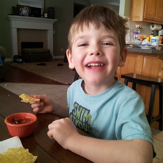 Enjoying homemade salsa with my biggest buddy. I have him his love for salsa while he was still in utero.