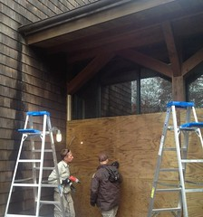 PHOTO: Boarding up the Kettle Pond Visitor Center at Ninigret National Wildlife Refuge in preparation for Hurricane Sandy, 2012. Credit: USFWS