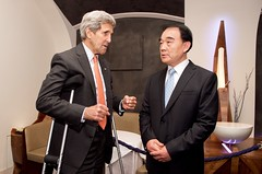 U.S. Secretary of State John Kerry chats with Chinese Vice Foreign Minister Li Baodong on June 28, 2015, in Vienna, Austria, before a working lunch amid their negotiations with Iranian leaders about the future of their nuclear program. [State Department Photo/Public Domain]