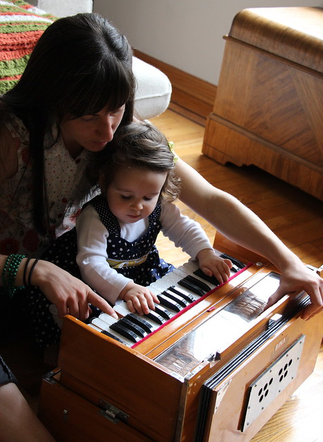 Sara playing harmonium with Celeste