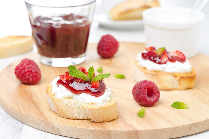 toast with soft cheese and raspberry