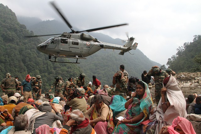 Survivors of floods and landslides in India's Himalayan state of Uttarakhand wait to be evacuated by the Indian force from Gaurikund village, near the epicentre of the disaster on June 23, 2013. The government says that almost 6,000 people who are missing are to be presumed dead one month after the disaster struck. Credit: Air Commodore Rajesh Isser/Indian Air Force
