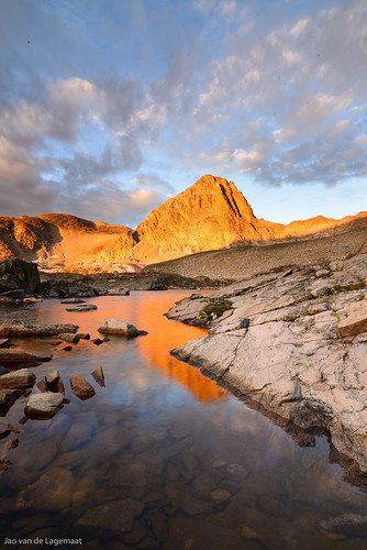 usa sun mountain lake mountains color colour reflection water clouds sunrise landscape dawn colorado unitedstates nederland northamerica indianpeakswilderness mounttoll upperbluelake