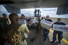 Sailors from USS George Washington (CVN 73) and Marines from the 3d Marine Expeditionary Brigade load boxes of supplies into a U.S. Marine Corps MV-22 Osprey, Nov. 20 in Tacloban. George Washington has been replaced by USS Ashland (LSD 48) and USS Germantown (LSD 42) in support of Operation Damayan. (U.S. Navy photo by Mass Communication Specialist 2nd Class Trevor Welsh)