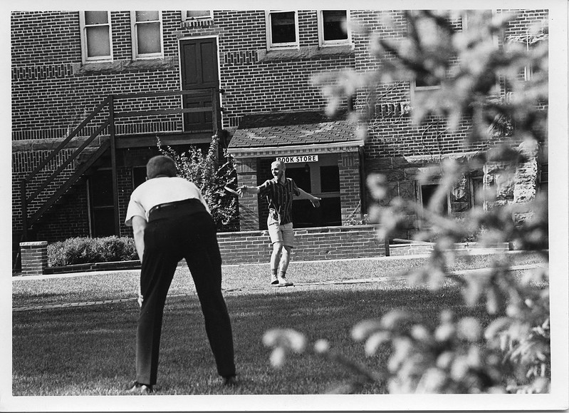 Students play Frisbee on the South Lawn of Alumni Hall in 1965