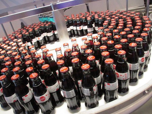 Reach right in and grab a bottle of Coca-Cola!
