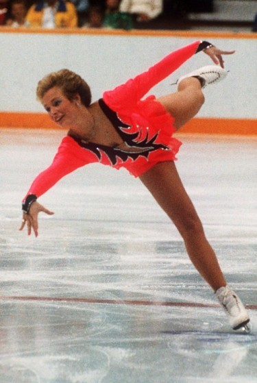 claudie leistner, skating in a bright orange outfit