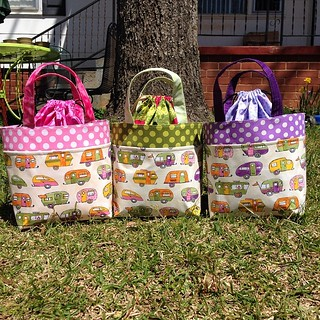I've been promising the girls is make them a #bentobag forever. Their best friend's birthday party is tonight, so I made matching bags for them and their friend. How fortunate that I happened to have a fabric I could trim out with each of their favorite c