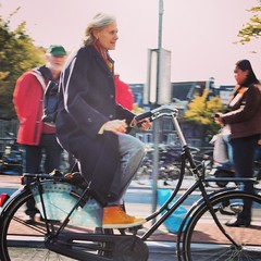 Lady cycling in Amsterdam #Amsterdam #dutchbike #coolshoes #dutch #women #greyhair #bikeams #cyclechic #cycling #bicycle