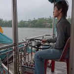 Dragon Boat Driver with the Battery at his Feet