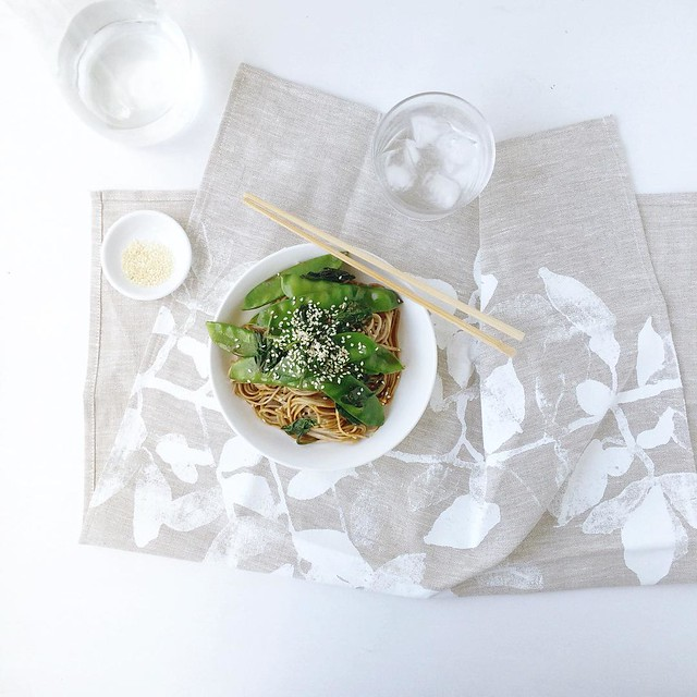 Soba, snow peas, spinach, sesame, soy. Plus a gorgeous linen tea towel, screenprinted by @sherylcole with her own illustration, that arrived just in time to be put to work. ????  (Seriously though, go check out her her stunning watercolour prints and gr
