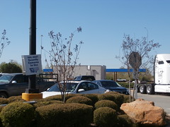 Rear view of new fuel center, with old security camera sign in the foreground