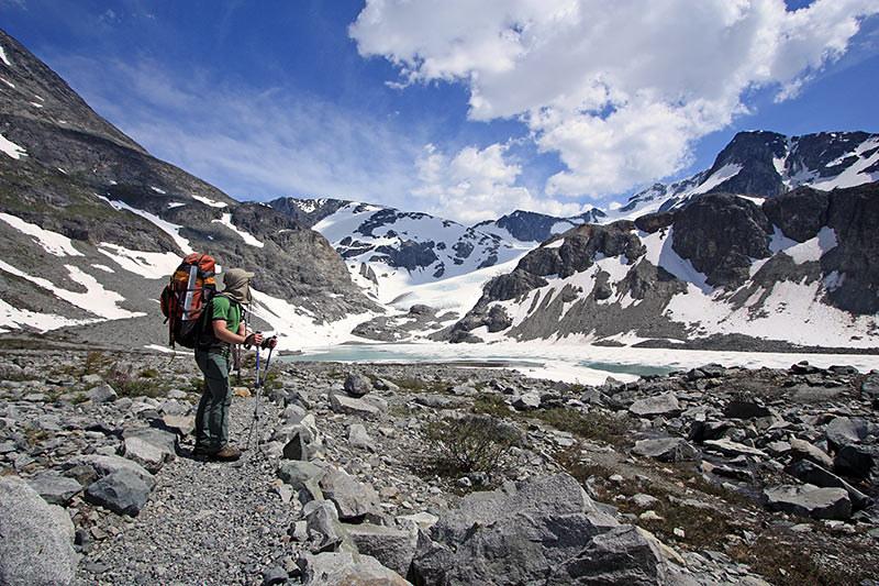 Backpacker enjoying the mountain views in Wedgemount Lake Area of Garibaldi Park near Whistler, British Columbia