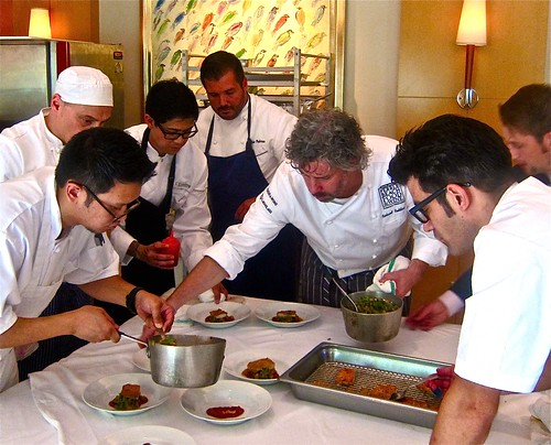 chefs plating fifty dishes for the lunch guests