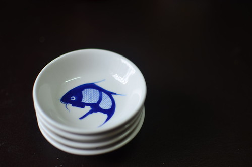 Tiny chinese bowls with fish
