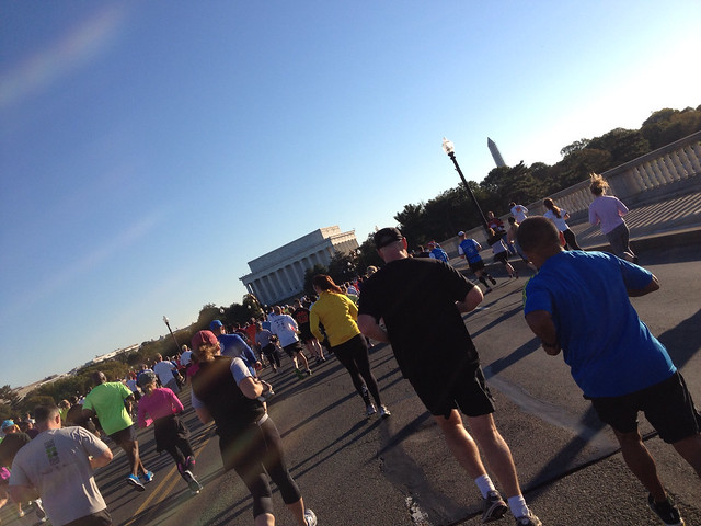 Running across Memorial Bridge toward the Lincoln Memorial early in the race