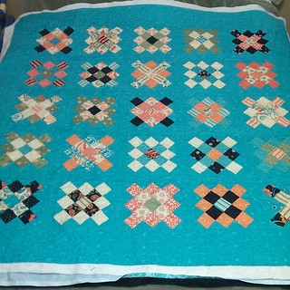 Some thread tails to bury but fmq is done. Just don't look to closely ☺ One of the main reasons I prefer using the longarm. #grannysquares #westwoodacresgiveaway #finishit2013 @acraftyfox_amanda thanks for the push!