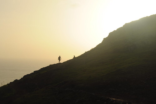 Silhouetted walker at sunset Ponta de São Lourenço