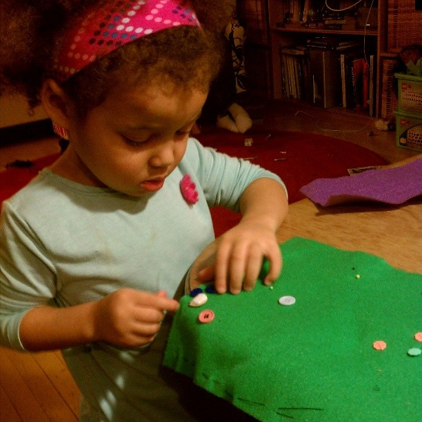 Learning to sew on buttons. #mytoddlersews #isew