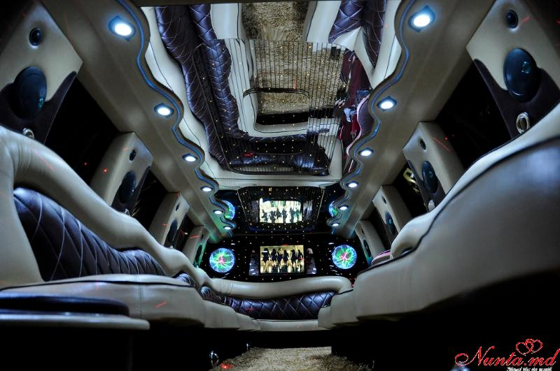 Limuzinei în Moldova Chişinău «Prestige Limo» Reduceri -20% > Foto din galeria `Ford Excursion anul fabricarii 2004,lungimea 12m, pasageri 24`