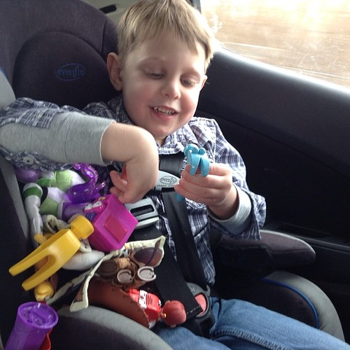 "#latergram of Henry trying to shove all of ""Woody's guys"" under his armpit for safekeeping during the car trip. My little hoarder has to touch all of his favorite toys at once. At least he is excited to be in the car and headed to Wisconsin    6 more hour"