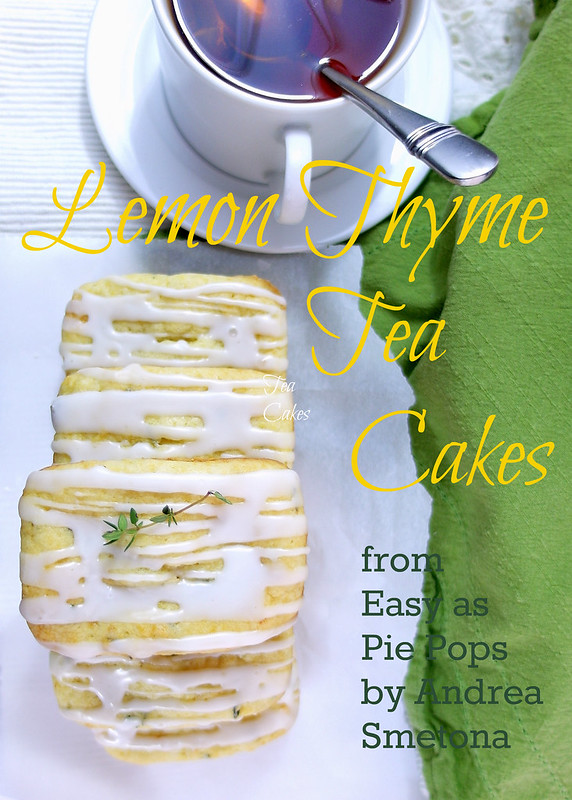 A Lemon Thyme Tea Cake on a white napkin next to a white cup of tea with a spoon resting in it. Text reads: Lemon Thyme Tea Cakes from Easy as Pie Pops by Andrea Smetona.
