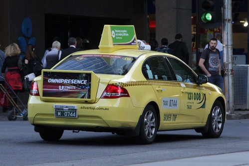 Rear and rooftop taxi advertising from 'Ultimate Media'