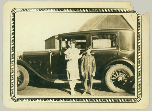 Two children and the car