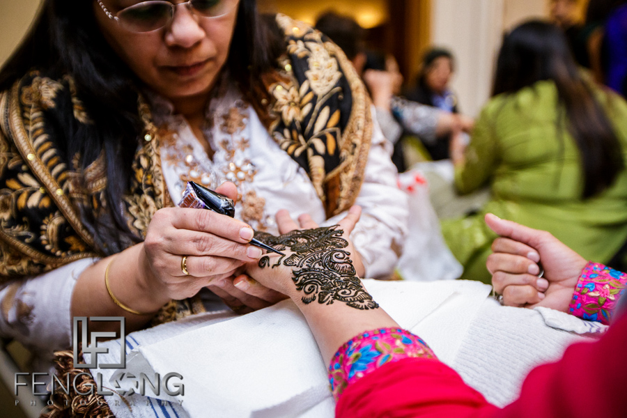 Guest getting henna art applied