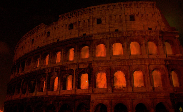 Burning colosseum at night