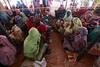 Women await their turn to collect their vouchers. Thanks to ECHO contributions, the vouchers are distributed for a period of two weeks per month which beneficiaries exchange for food items that will enable them to feed their families throughout the month.  ‾‾‾‾‾‾‾‾‾‾‾‾‾‾‾‾‾‾‾‾‾‾‾‾‾‾ Des femmes attendent leur tour pour obtenir des bons. Grâce à l'aide d'ECHO, les bons d'achat sont distribués deux fois par mois. Les bénéficiaires peuvent les échanger contre des produits alimentaires et nourrir ainsi leur famille pendant tout le mois.  Photo credit: WFP/Mohamed Nureldin Abdallah