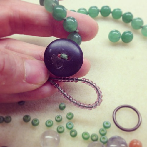 Adding a handmade button clasp to a new necklace design today!