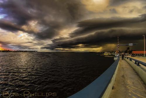 sunset storm gulfofmexico rain clouds florida drawbridge matlacha pineisland pineislandsound