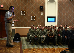 Pacific Fleet Master Chief Marco Ramirez answers questions while addressing Seabees from Naval Mobile Construction Battalion 3, Nov. 20. (U.S. Navy photo by Mass Communication Specialist 1st Class Chris Fahey)