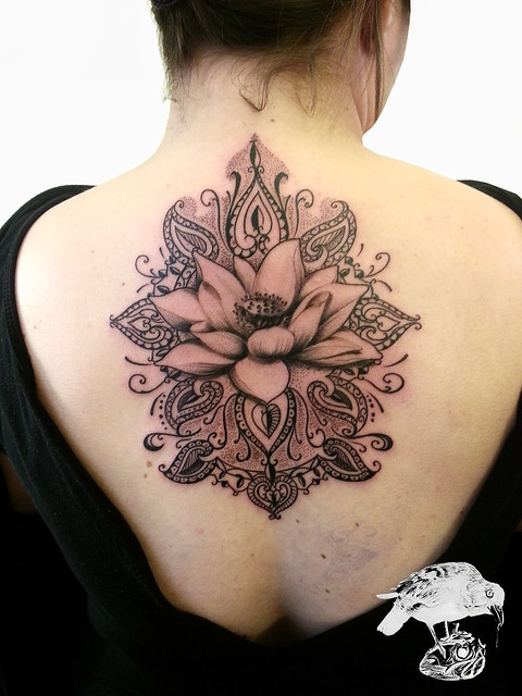 henna pattern tattoo on back with lotus flower