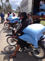 Philippines: Farmers carry rice seeds on motorbikes