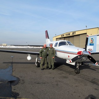 NEW YORK – U.S. Coast Guard Auxiliarists Lou Volpato; Division One Commander and first pilot, left, and Ron Kaplan; Flotilla 12-07 Commander and aircraft commander from the Coast Guard Auxiliary's Air division, stand next to Kaplan's aircraft Malibu Mirage in Ronkonkoma, N.Y., Feb. 1, 2014. Kaplan and Volpato flew along Long Island, New York Harbor and Hudson River, N.Y., conducting ice observations in support of Operation Reliable Energy Northeast Winter. U.S. Coast Guard photo by Petty Officer 2nd Class Jetta H. Disco.