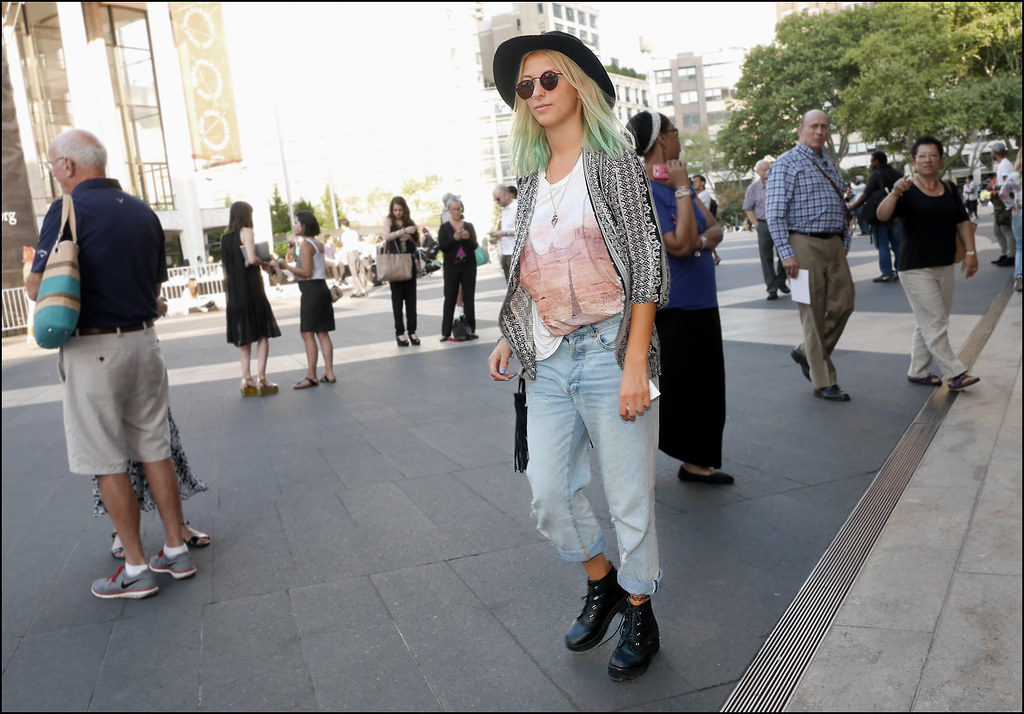 SS7-15 15w boho black white print jacekt over faded tee pale blue faded jeans aqua hair black hat round shades combat boots